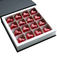 Valentine's Red Heart Chocolates in Open Chocolate Gift Box Angled
