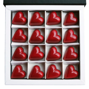 Valentine's Red Heart Chocolates in Open Chocolate Gift Box Overhead