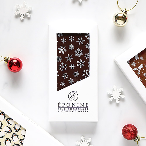 Snowflake Christmas Dark Chocolate Bar Overhead with Festive Decorations