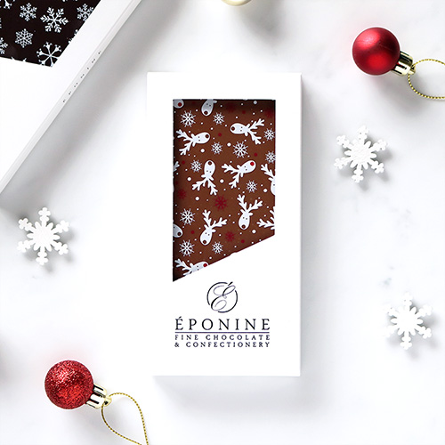 Reindeer Christmas Milk Chocolate Bar Overhead with Festive Decorations