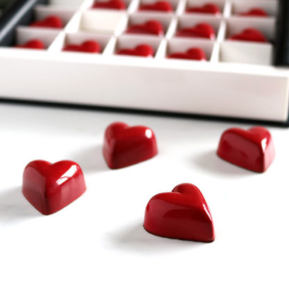 Caramel & Gianduja Red Heart Chocolates Closeup Angled