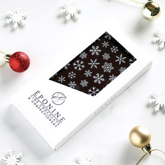 Snowflake Christmas Dark Chocolate Bar Angled with Festive Decorations