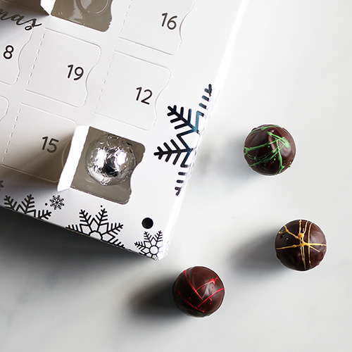 Luxury Advent Calendar with Chocolates In and Out of Window Overhead Close Up
