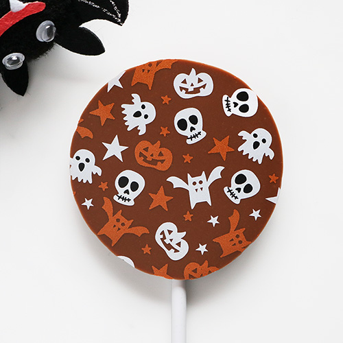 Milk Chocolate Halloween Lollipop with Seasonal Pattern Peeking Bat Overhead