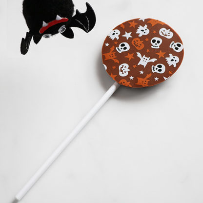 Milk Chocolate Halloween Lollipop with Seasonal Pattern Floating Bat Overhead