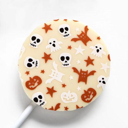 White Chocolate Halloween Lollipop with Seasonal Pattern Overhead Close Up