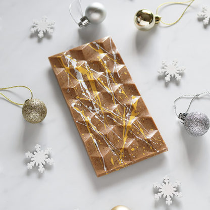 Mince Pie Christmas Vegan Chocolate Bar Unboxed Angled with Festive Decorations